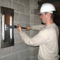 installing a wall anchor to repair an bowing foundation wall in Rancho Cordova