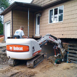 Excavating to expose the foundation walls and footings for a replacement job in Davis