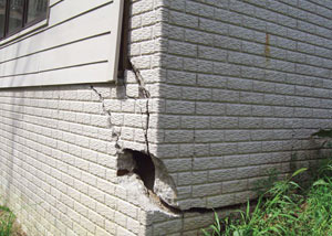 A severely damaged foundation wall in Folsom